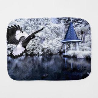 Black-and-white print of ducks, a lake, and a gaze burp cloth