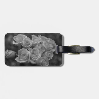 Black and white roses against spotted background bag tags