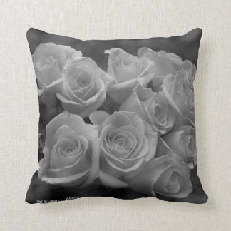 Black and white roses against spotted background throw pillow