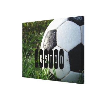 Black and White Soccer Ball in Green Grass Canvas Print