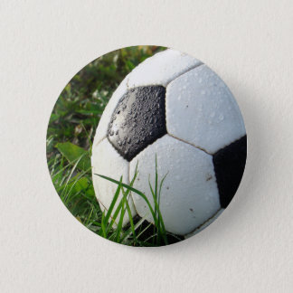 Black and White Soccer Ball in Green Grass Pinback Button