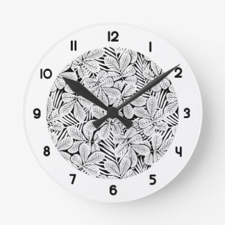 Black and white tropical plants round clock