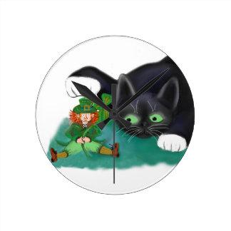 Black and White Tuxedo Kitten Tags his Leprechaun Round Clocks
