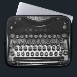 "Black and White Typewriter Laptop Sleeve<br><div class=""desc"">Amazing still life of an old typewriter.  Fun and unique design.</div>"