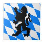 "Black Bavarian Lion Ceramic Tile<br><div class=""desc"">Black shape of a lion rampant based on a Bavarian symbol on azure and white diamond pattern.</div>"