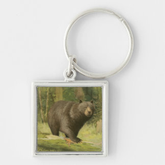 Black Bear Stepping on a Tree Trunk Keychain