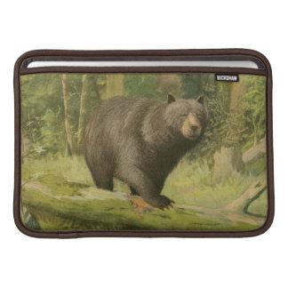 Black Bear Stepping on a Tree Trunk MacBook Sleeve