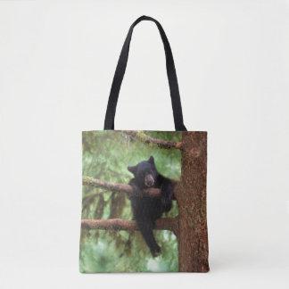 black bear, Ursus americanus, cub in a tree Tote Bag