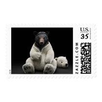 Black bear wearing polar bear costume postage