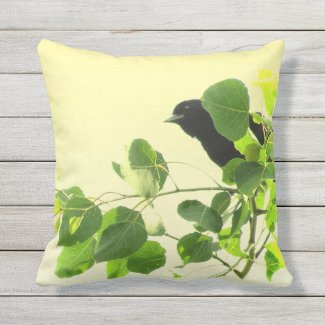 Black Bird Green Leaves on Yellow Outdoor Pillow