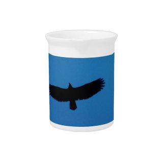 Black bird in a Blue Sky Drink Pitchers
