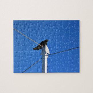 Black bird on a post jigsaw puzzles