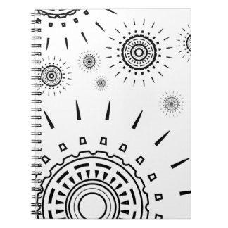 Black Burst Patterns on White Notebook