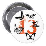 Black butterflies on orange '13' button. pinback button