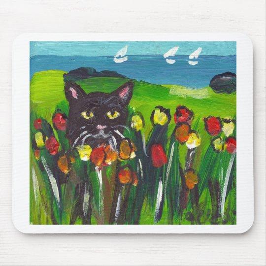 Black cat amongst tulips mouse pad