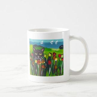 Black cat amongst tulips mug