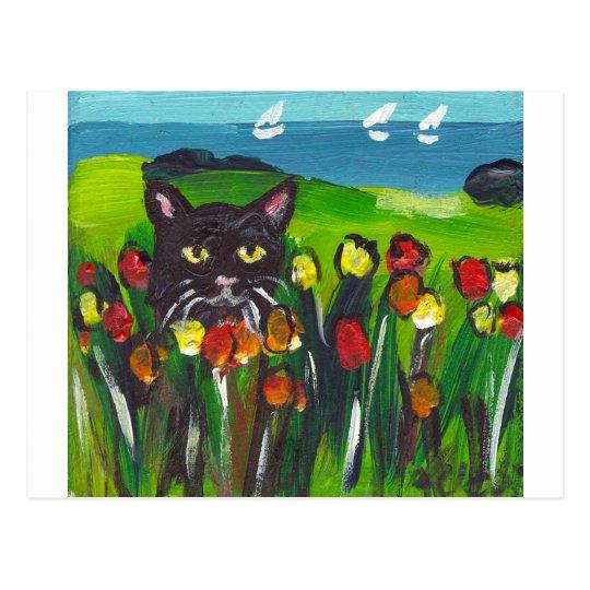 Black cat amongst tulips postcard