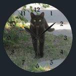 "Black Cat in a Garden Large Clock<br><div class=""desc"">A Photo of a Black Cat in a Garden</div>"