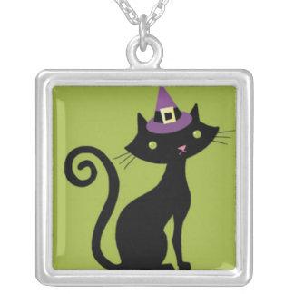 Black Cat on Green Background Pendants