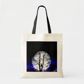black cat on tree bag