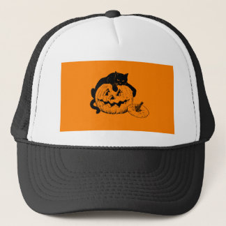 Black Cat Resting On Top of a Carved Pumpkin Trucker Hat