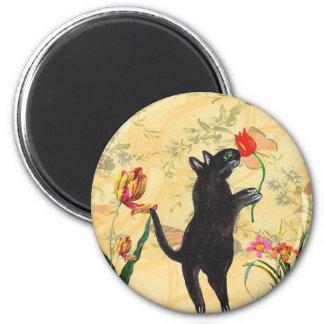 black cat smelling tulip vintage magnet