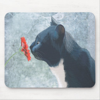 Black Cat Sniffing Flower Mouse Pad