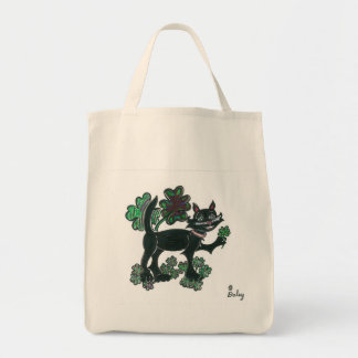 Black Cat standing over those four leaf clovers. Tote Bags