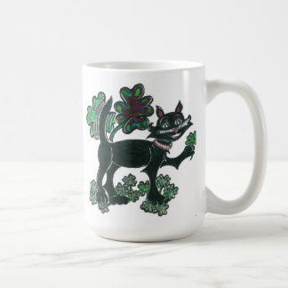 Black Cat standing over those four leaf clovers. Mugs