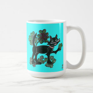 Black Cat standing over those four leaf Clovers Mugs