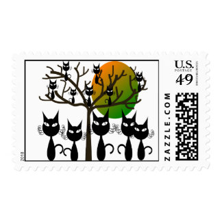 Black cats taking over postage stamp