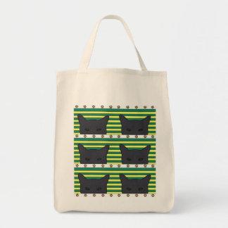 black cats, yellow/green stripe, paw print tote bag
