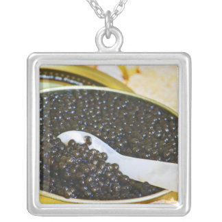 Black caviar and a spoon of mother-of-pearl to square pendant necklace