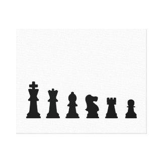 Black chess pieces on white canvas print