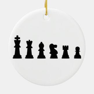 Black chess pieces on white ceramic ornament