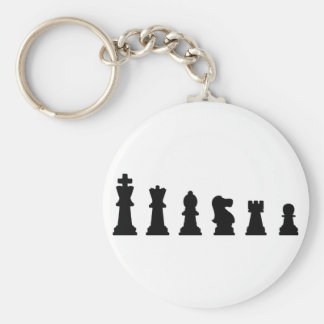 Black chess pieces on white keychain