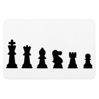 Black chess pieces on white rectangle magnet