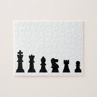 Black chess pieces on white puzzle