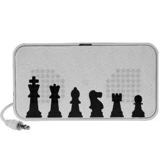 Black chess pieces on white iPod speaker