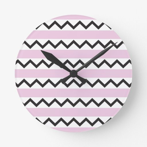 Black chevron zigzags and pale pink stripes round wall clocks
