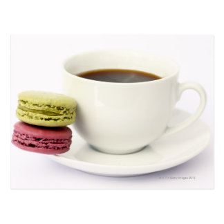 Black coffee in white cup with two french postcard