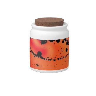 black color splash, red candy jar