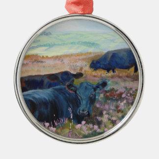 Black cow lying down christmas tree ornament