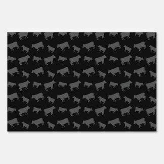 Black cows lawn signs