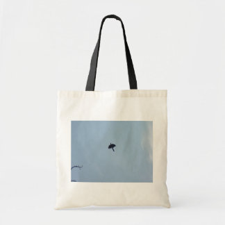Black Crow Flying Fast Over The Head In Blue Sky Bag