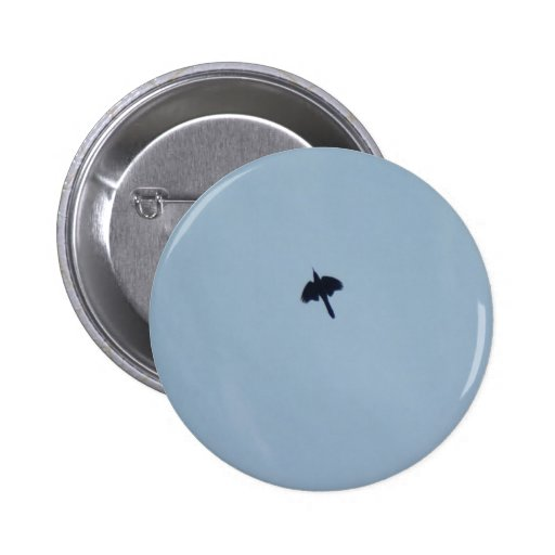 Black Crow Flying Fast Over The Head In Blue Sky Pin