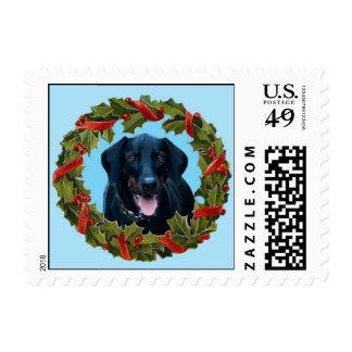 Black Doberman Dog Christmas Wreath on blue stamps