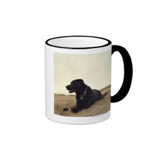 Black dog on sand with stick coffee mug