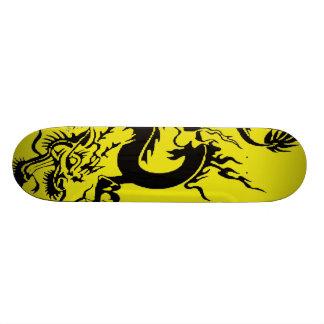black dragon on yellow skate board deck
