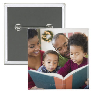 Black family reading book together button